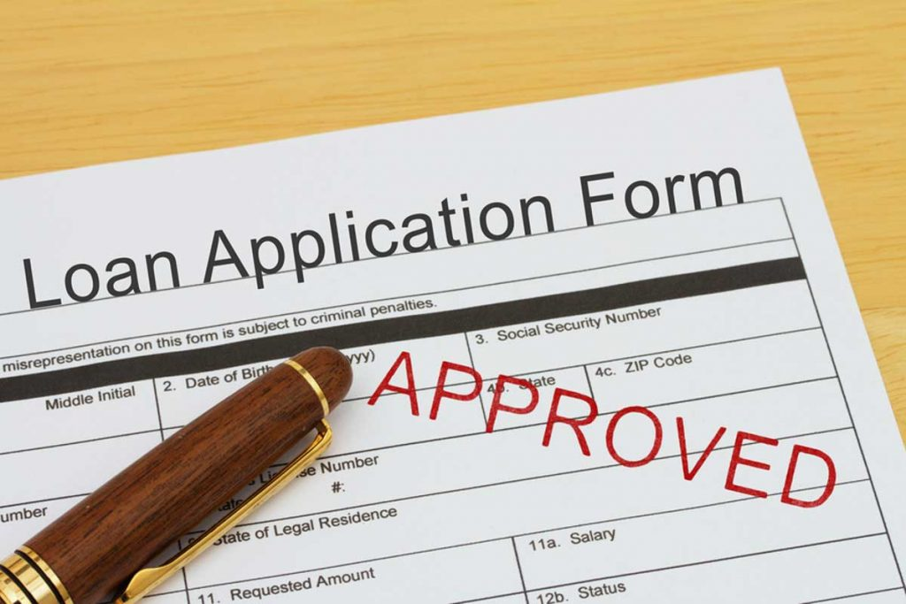 Loan application form marked approved