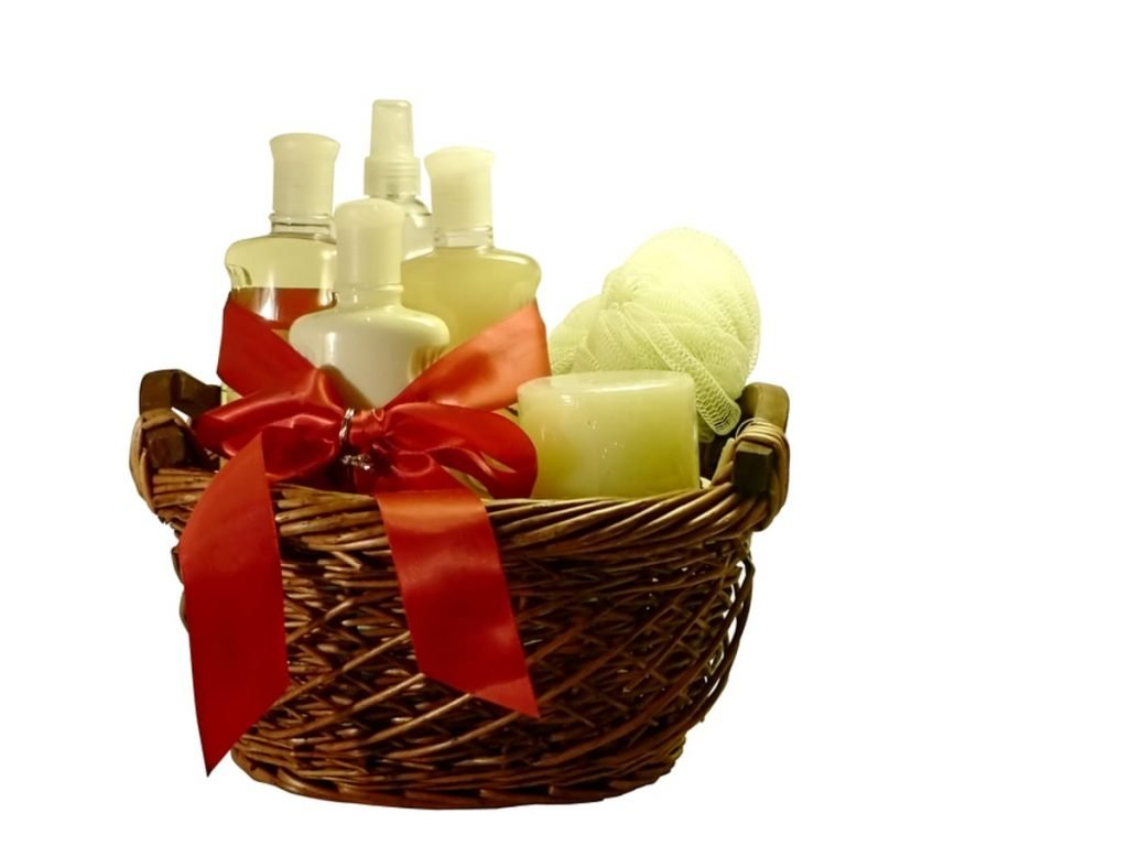 Basket with lotions, soaps and candles.