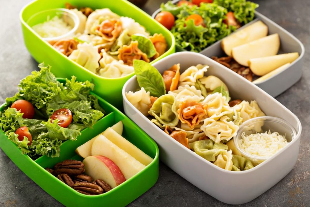 Dishes with salads, fruits and nuts.
