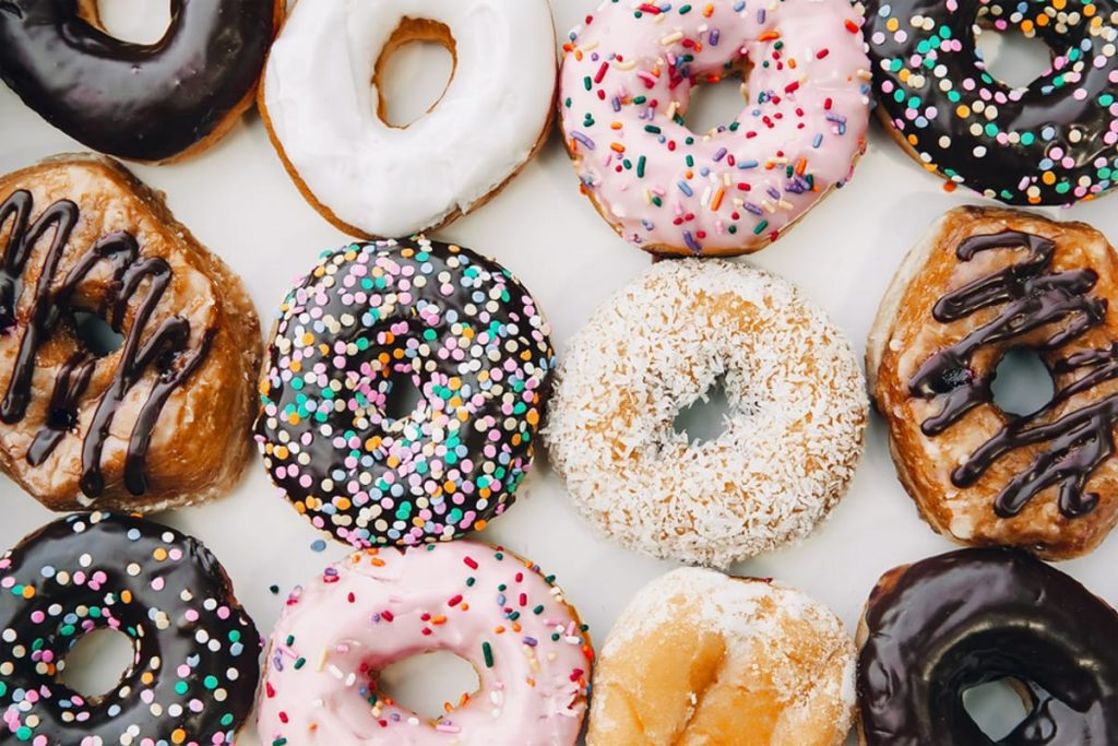 Donuts with many frosted toppings.