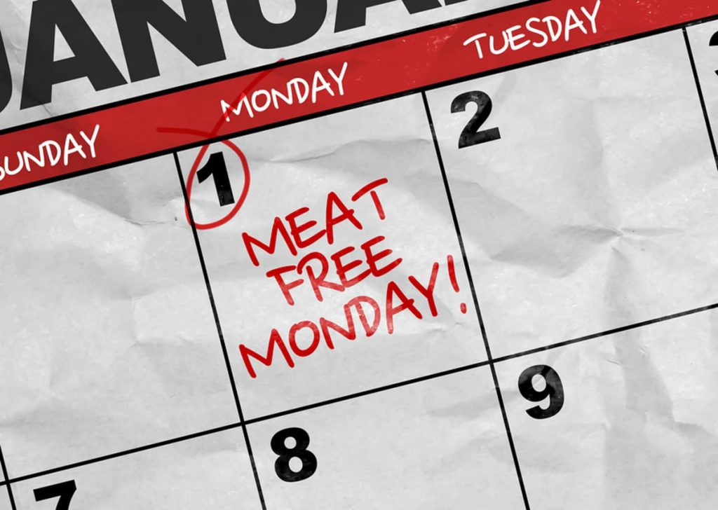 Paper monthly calendar with the words Meat Free Monday written on the 1st Monday.
