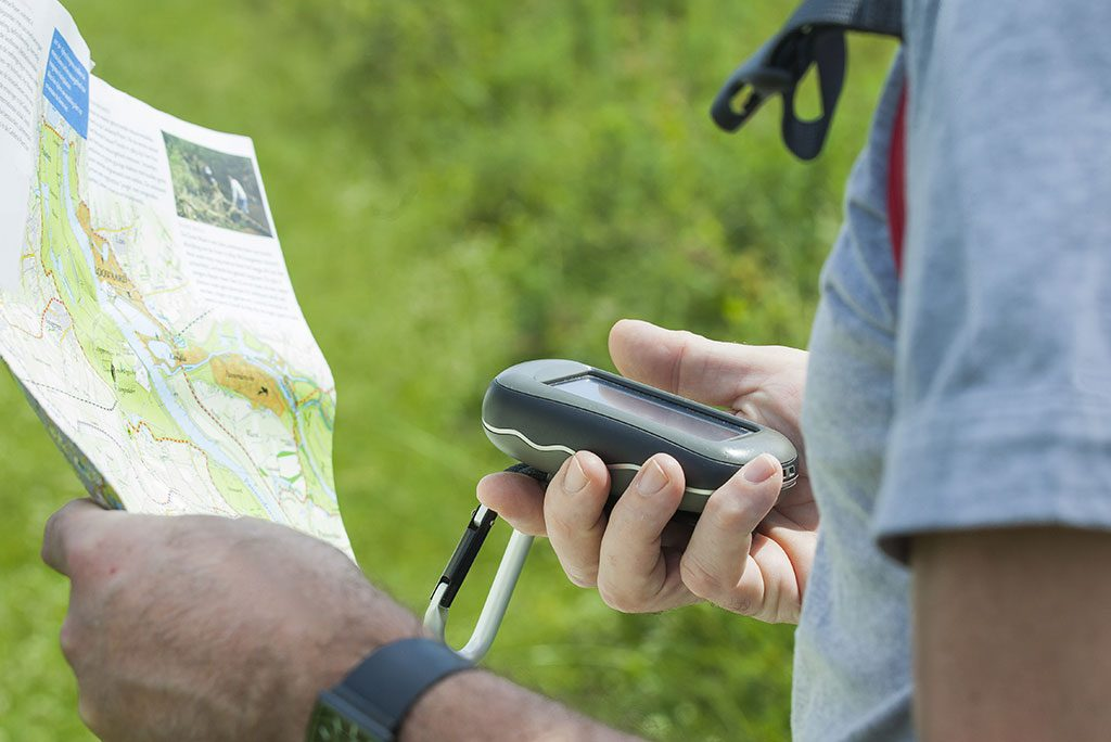 A guy with a map and GPS