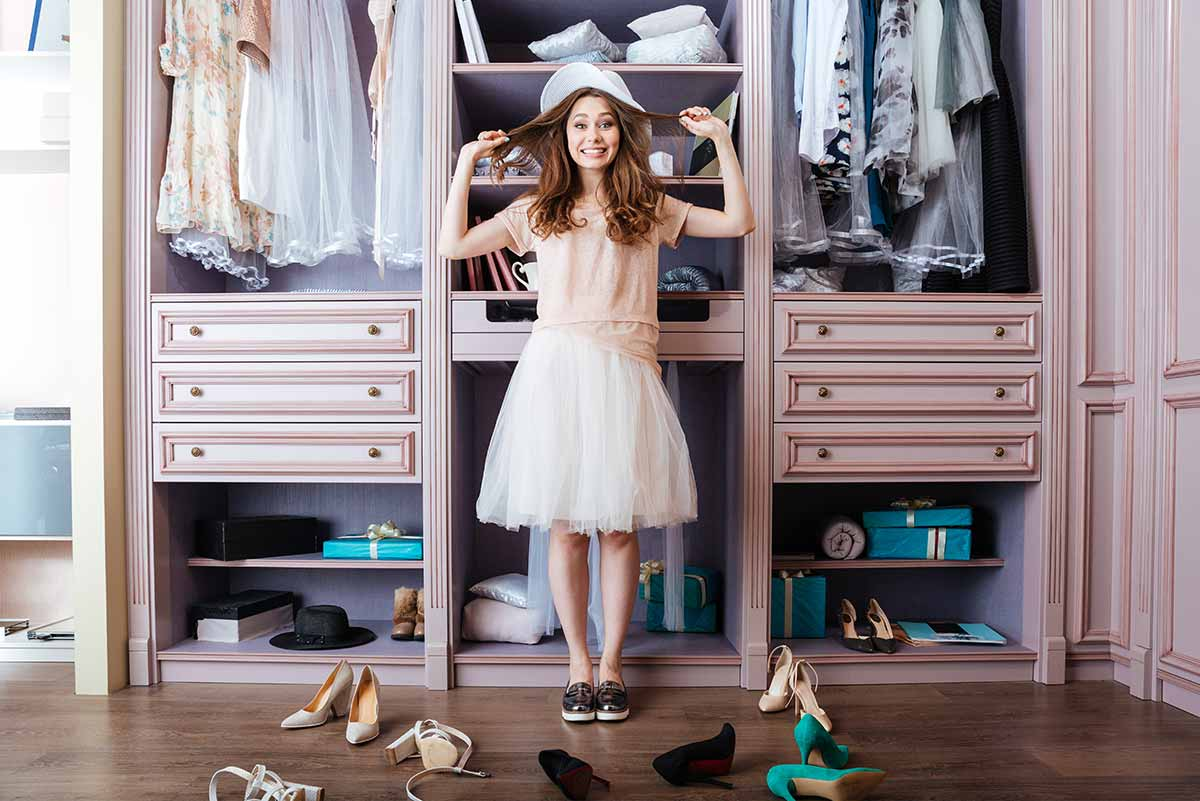 A girl standing in front of her closet